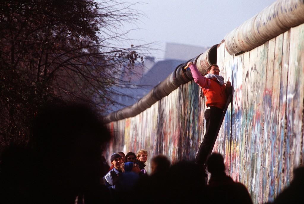 Man helping demolish Berlin Wall